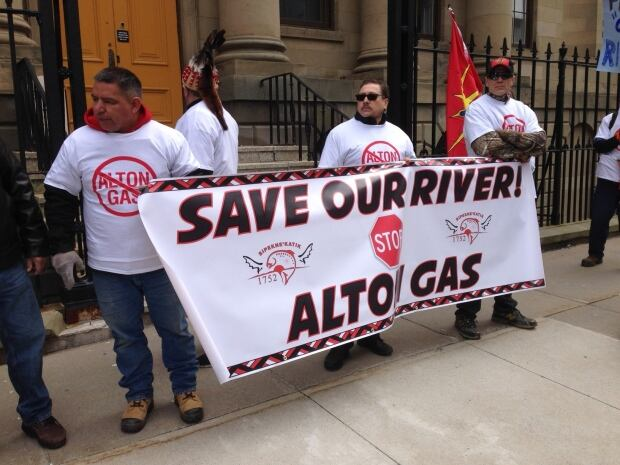 Three men protest proposed natural gas storage project