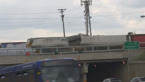 A CN train derailed just before 5 a.m. on Sunday on the overpass above 97 street.
