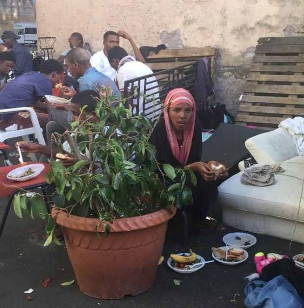 Female migrant rests in Rome