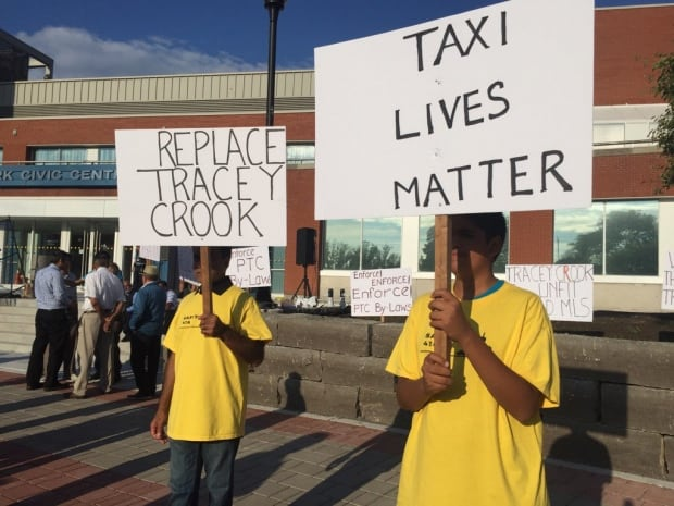 Toronto taxi drivers criticized Cook at a protest earlier this week. (Linda Ward/CBC)