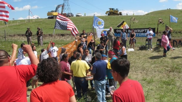 Indigenous people protest the Dakota Access oil pipeline near the Standing Rock Sioux reservation in North Dakota on Aug. 12, 2016.