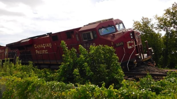 Two freight trains collided in Toronto early Sunday, causing cars to derail. One of the train's engines leaked diesel fuel but crews have contained the leak.
