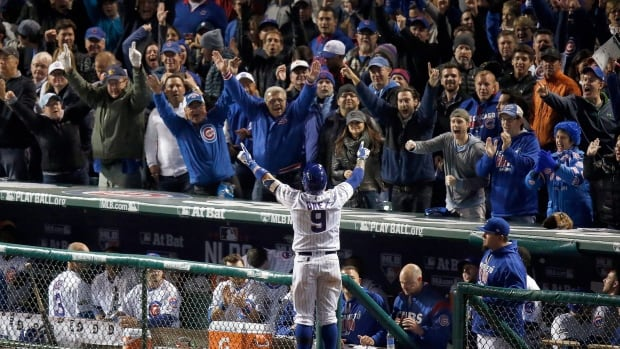 Chicago Cubs' Javier Baez celebrates after hitting a go-ahead home run in the eighth inning against the San Francisco Giants. The Cubs won Game 1 of the NLDS 1-0. (Charles Rex Arbogast/The Associated Press)