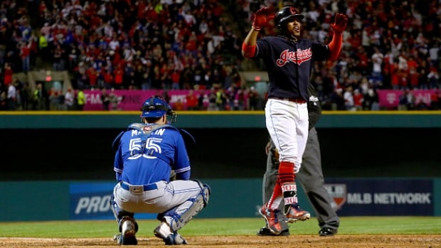 Corey Kluber and two other Indians pitchers combined on a shutout and Francisco Lindor's two-run homer lifted Cleveland to a 2-0 victory over the Toronto Blue Jays on Friday night in Game 1 of the American League Championship Series.