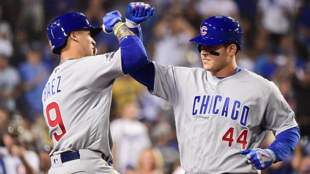 Anthony Rizzo, right, celebrates with Javier Baez during the Cubs' 10-2 win against the Dodgers in Game 4. Anthony Rizzo, right, celebrates with Javier Baez during the Cubs' 10-2 win against the Dodgers in Game 4. (Harry How/Getty Images)
