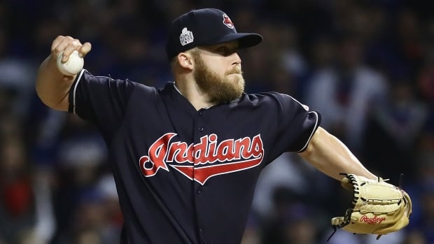 Cody Allen escaped a ninth-inning jam and the Cleveland Indians pitched their fifth shutout this post-season, holding off the Chicago Cubs 1-0 Friday night for a 2-1 lead as the World Series returned to Wrigley Field for the first time since 1945.
