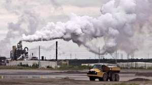 Alberta's oil sands are taking steps to control COVID-19, as total cases exceed 1,000