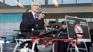 Transport Minister Marc Garneau announces new safety restrictions on recreational drones at Billy Bishop airport in Toronto on Thursday.