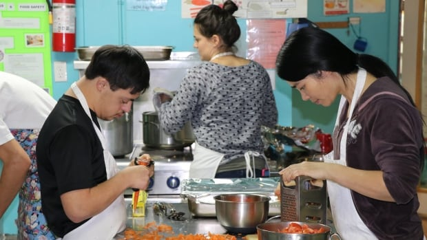 Staff at the Downtown Eastside Neighbourhood House prepare meals with ingredients provided in part by the Greater Vancouver Food Bank.