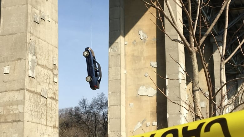 Toronto Police Arrived Wednesday To Find The Car Dangling From The Bridge With No Engine No Passengers Inside And The Area Cordoned Off By Yellow Tape