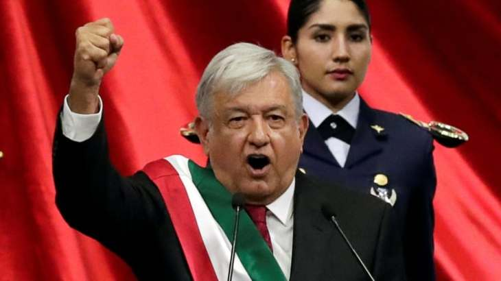 Mexico's new president, Andres Manuel Lopez Obrador, gestures during his inauguration ceremony at the Mexican Congress, in Mexico City on Saturday. (Henry Romero/Reuters)