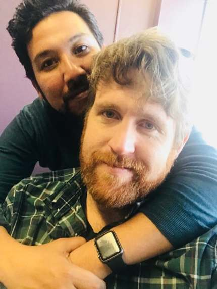 Ricardo Miranda and Christopher Brown hugging and smiling