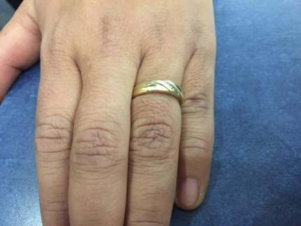 Ricardo Miranda engagement gold ring with four diamonds from gay partner Christopher Brown