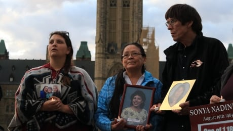 Families stand together at vigil in Ottawa