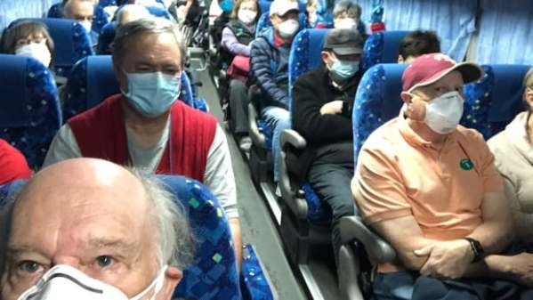 Americans to fly home from coronavirus-hit cruise; China says new cases slowing