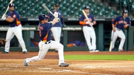 Cheating scandal looms over baseball's pandemic return