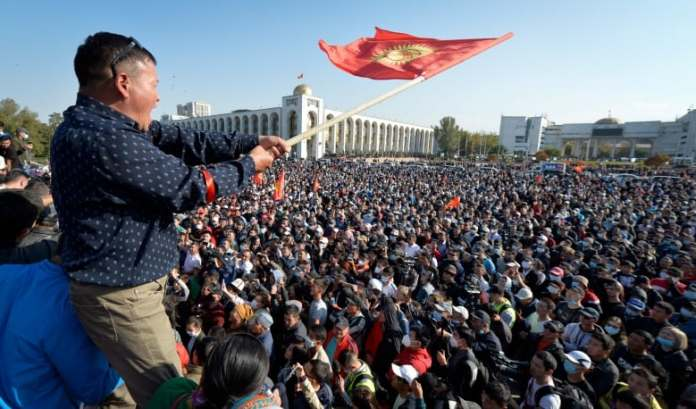 Kyrgyzstan on edge of chaos after opposition storms government buildings