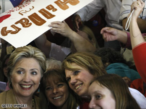 Hillary Clinton takes a picture with supporters in Indiana.