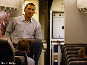 Obama takes a breather on board the campaign plane.
