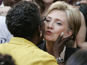 Sen. Hillary Clinton gets a kiss from Rep. Stephanie Tubbs Jones during a rally in Washington on June 7, where she suspended her campaign for president.