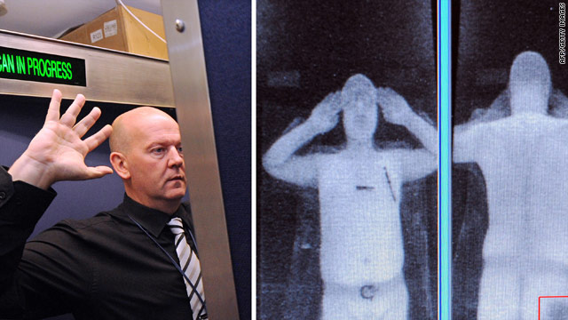 A staff member demonstrates a full body scan at Manchester Airport in the UK