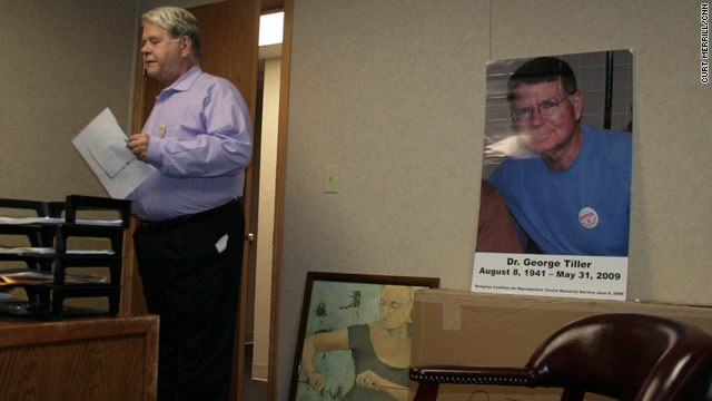 Dr. LeRoy Carhart pauses in his Nebraska office near a poster of his best friend, George Tiller, who was killed in May.