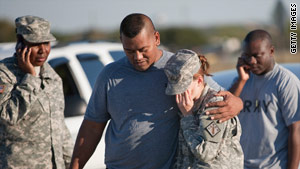 Sgt. Fanuaee Vea, left, embraces Pvt. Savannah Green outside Fort Hood in Texas on Thursday.