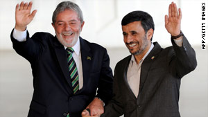 Brazilian leader Luiz Inacio Lula da Silva, left, greets Iranian President Mahmoud Ahmadinejad in Brasilia on Monday.
