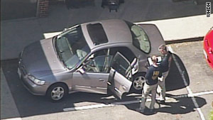 FBI agents search a car in Brookline, Massachusetts, on Thursday.