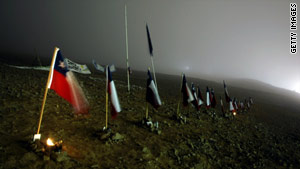 The row of national flags outside the mine represent the 33 trapped miners in Copiapo.