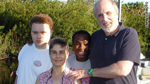 Bill Barry and Joan Jacobson pose with their two sons, Willie, left, and Alex, whom they adopted as newborns.