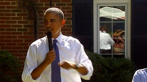 President Obama talked to a small group Monday outside the home of a family in Fairfax, Virginia.