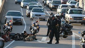Protesters block a portion of Interstate-880 during Thursday's National Day of Action against school funding cuts.