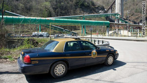 A West Virginia state police car is parked Tuesday outside the coal mine where Monday's fatal blast happened.