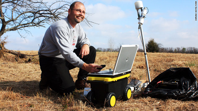 Scott Ausbrooks, geohazards supervisor for the U.S. Geological Survey, collects data from a seismic monitoring station.