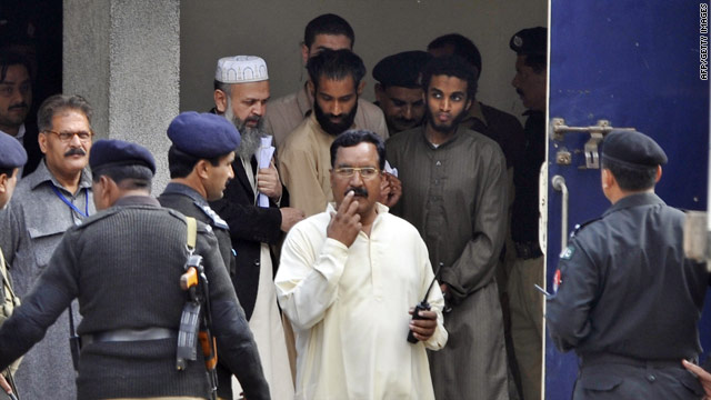 Five American terror suspects leave a court in Pakistan on Tuesday.