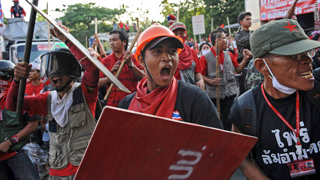 """""""Red Shirt"""" anti-government protesters take to the streets Friday in Bangkok."""