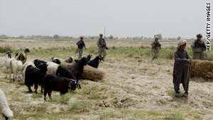 U.S. troops patrol near a shepherd and his flock in Kandahar province, Afghanistan.