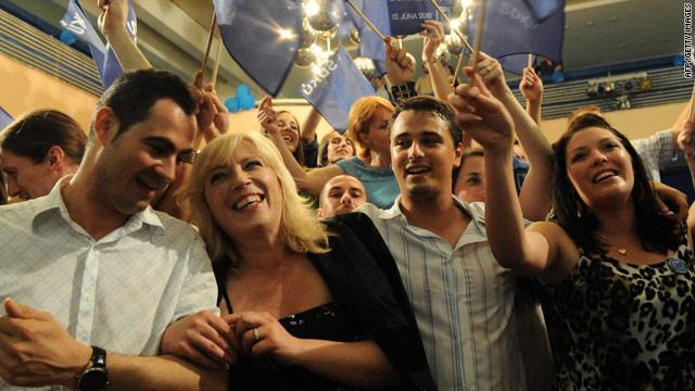 Slovak Democratic Christian Union leader, Iveta Radicova, second left, celebrates with supporters.