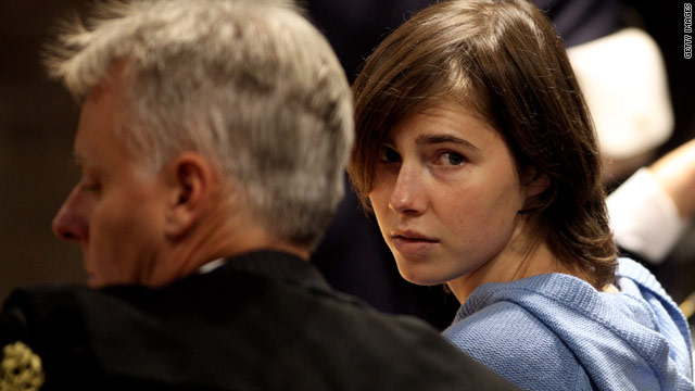 AAmanda Knox speaks to her legal team on Wednesday during her appeal against her murder conviction.