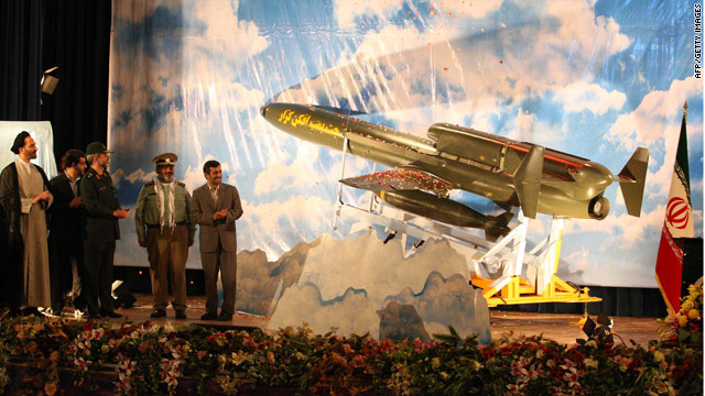 """An Iranian Defense Ministry photo shows President Ahmadinejad and the long-range drone dubbed """"Karrar"""" on August 22, 2010."""