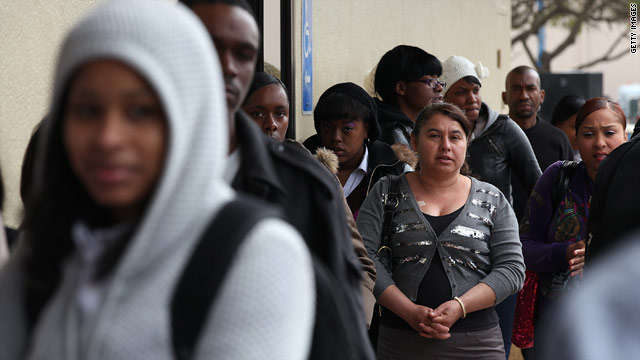 Job seekers wait in line at a one-day hiring event April 19 at a McDonald's in San Francisco. Hundreds showed up to apply.