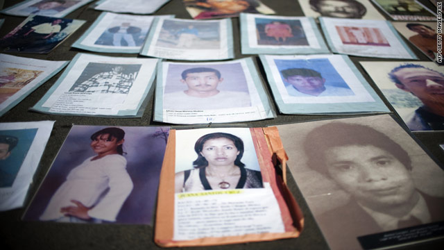 Loved ones of Honduran migrants missing in Mexico laid out their photos in a demonstration in Mexico City last November.