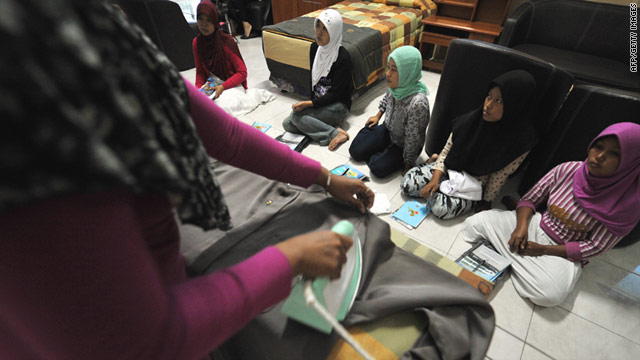 Indonesian workers applying to work in Saudi Arabia attend a training centre in Jakarta.