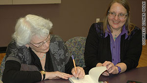 Co-editors Rochelle Saidel, left, and Sonja Hedgepeth sign copies of their book at a Brandeis University event.