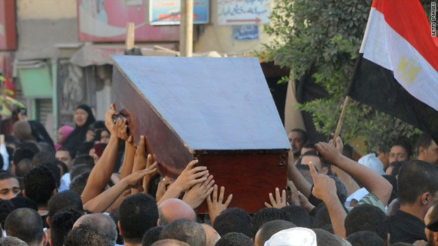 Mourners carry the coffin of one of the security officers killed along the Egypt-Israel border.