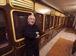House trained: Retired transport manager Mr Higgins, 64, originally from Buckinghamshire took over the property from his former father-law Charles Allen who was forced to build it around the railway carriage