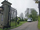A policeman stands guard at the Down Hall Country House Hotel in Essex, where a man and a woman were discovered dead in the swimming pool on Saturday night