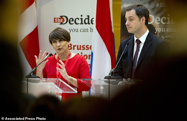 Belgium's Deputy Prime Minister and Minister for Foreign Development and Cooperation Alexander De Croo, right, and Dutch Minister for Trade and Development Cooperation Lilianne Plouman, left, address a media conference, She Decides, at the Egmont Palace in Brussels on Thursday, March 2, 2017. Nations are pledging tens of millions of dollars at an international family planning conference in Brussels aimed at making up for the gap left by President Donald Trump's ban on U.S. funding to groups linked to abortion. (AP Photo/Virginia Mayo)
