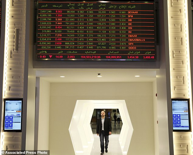 A stock ticker displays the share price and trade volume of Emaar Malls and others stock at the Dubai Financial Market in Dubai, United Arab Emirates, Monday, March 27, 2017. Dubai's Emaar Malls, a subsidiary of the state-backed construction firm Emaar, said Monday it made an $880-million offer to buy the online retailer Souq.com amid rumors of a possible acquisition of the firm by Amazon. (AP Photo/Jon Gambrell)